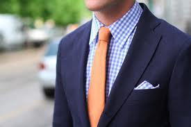 blue shirt with orange tie
