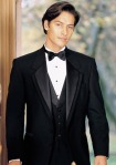 Tuxedo with a low waistcoat creates a look that is harmonious with the tuxedo itself