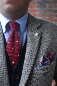 Tweed jacket perfectly paired with a knitted burgundy polka dot tie!