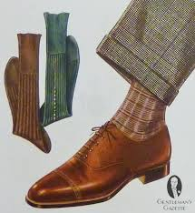 Brown socks that are a shade darker than the shoes can make for an elegant combination!