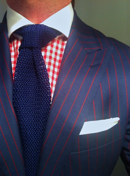 A pinstripe suit with a checkered / gingham shirt can work extremely well for taller men!