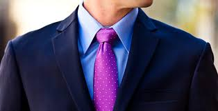 A blue shirt with a lilac tie provides a feeling of familiarity as both colors are fairly close to each other on the color wheel