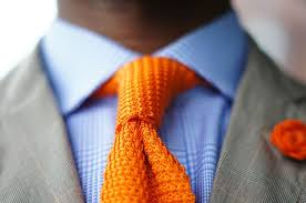 light blue shirt with an orange tie