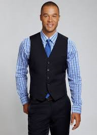 Bottom button of a vest should be left undone.  Picture courtesy of Bonobos.  http://www.bonobos.com